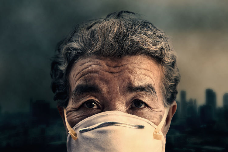 Old woman wearing a mask fear problem air pollution in the city, protect environment concept. Fear Woman Mask Protection Wearing Air Problem Face Health Environment Pollution City Smoke Urban Fog Danger
