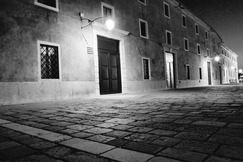 Black & White Alley Architecture Black And White Building Building Exterior Built Structure City Cobblestone Courtyard  Direction Empty Footpath Illuminated Lighting Equipment Nature Night No People Outdoors Paving Stone Residential District Stone Street Street Light The Way Forward
