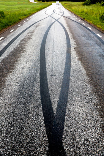 Tire tracks on road