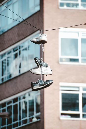 Close-up of electric lamp hanging on building