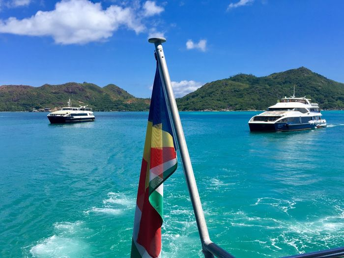 Seychellen Blue Water Ferry Color Flag Ocean Africa Vacations Travel Destinations Mode Of Transportation Transportation Nautical Vessel Water Sky Sea Day Nature Blue Travel Outdoors