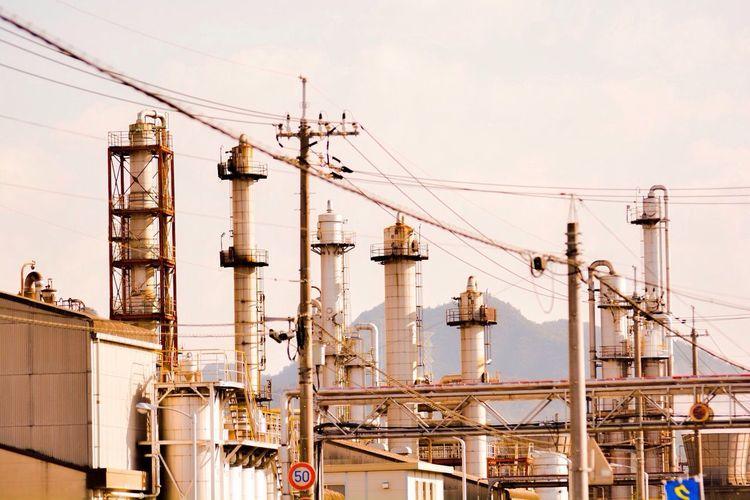 Smoke Stacks Of Oil Refinery