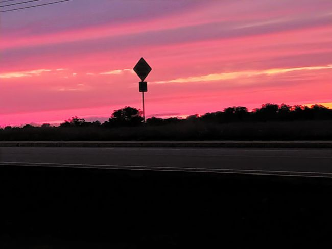 Red sky at night....sailors delight Red Sky At Night... LG V30 Rocking Red Pretty In Pink Sunset_collection Sunset Silhouettes Road Sign Sunset Road Silhouette Dusk Sky