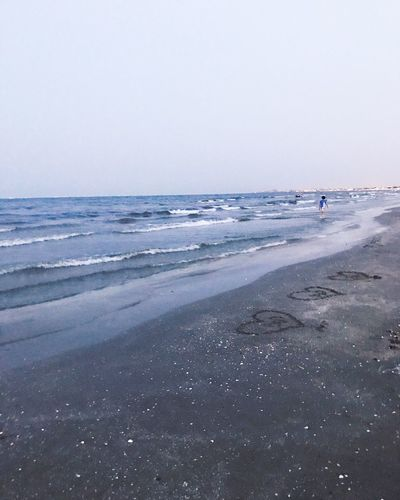 Beach Sea Sand Horizon Over Water Water Nature Scenics Vacations Real People Clear Sky Tranquility One Person Outdoors Sky Full Length Day People Beauty In Nature Tranquil Scene Wave