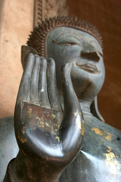 Hand and face. Buddah statue. Vientiane, Loas. Vientiane, Laos Art And Craft Close-up Craft Day Human Representation Indoors  Male Likeness No People Place Of Worship Religion Sculpture Spirituality Statue Travel Destinations
