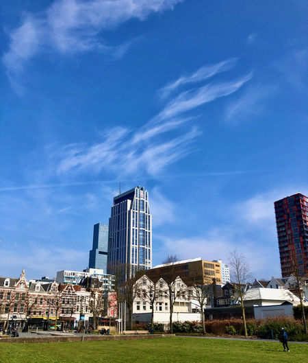Buildings in city against blue sky