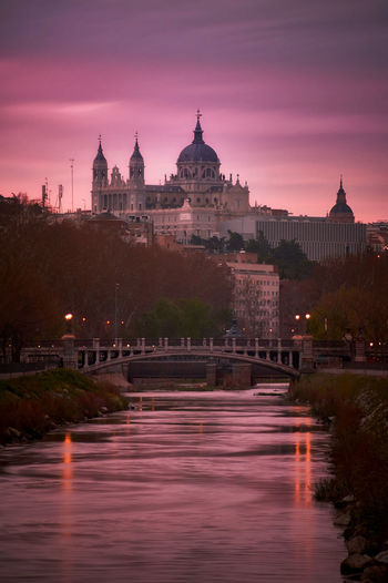 Purple sunrise EyeEmBestPics EyeEm Best Shots Clouds And Sky Cathedral Cityscape City Urban Skyline Water Bridge - Man Made Structure Reflection River Sky Historic Monument Palace