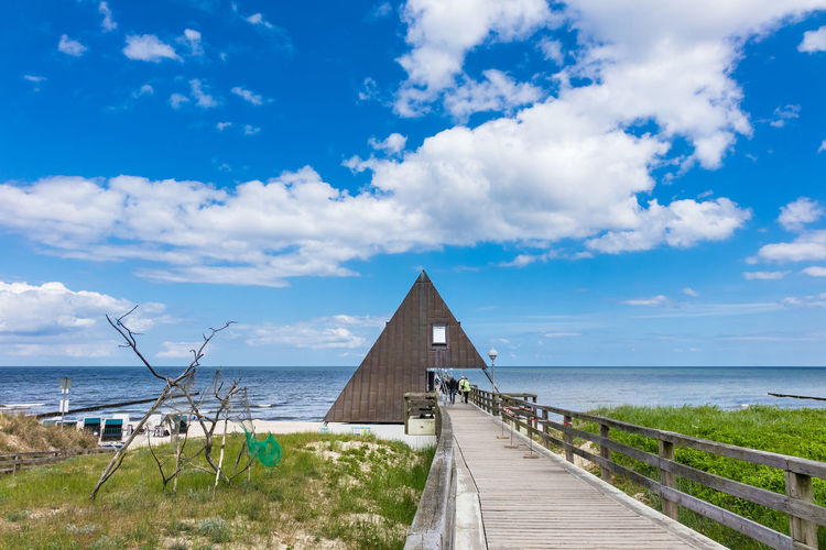 Pier on the Baltic Sea coast in Koserow, Germany. Architecture Baltic Sea Holiday Nature Pier Sky And Clouds Beach Building Exterior Clouds And Sky Coast Jetty Koserow Landmark Landscape Outdoors Shore Tourism Travel Destinations Usedom Vacation Water Waves