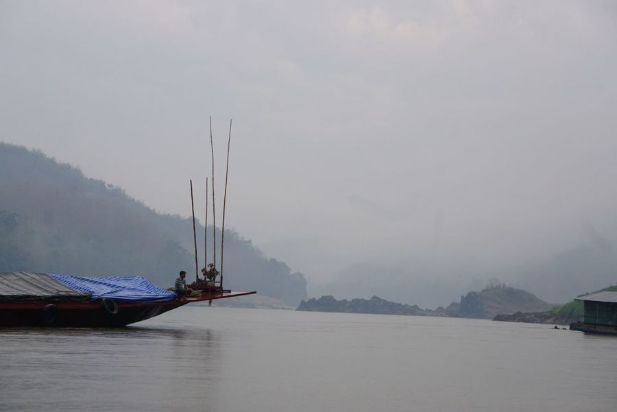 Nautical Vessel Tradition Fishing Mountain Landscape Business Finance And Industry Outdoors Nature Fishing Net Sea Day Fog No People Sky Water Tree Beauty In Nature Tranquility Nature Reflection Asian Culture ASIA People Architecture Fisherman