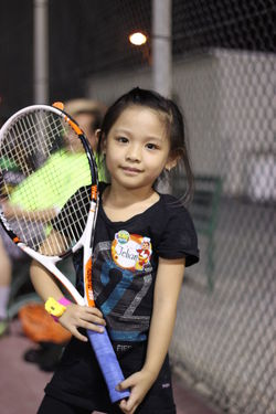 Beauty Cheerful Child Childhood Children Only Court Cute Girls Holding Leisure Activity Leisure Games Lifestyles Looking At Camera Motion One Girl Only One Person People Portrait Smiling Sport Standing Tennis Tennis Ball Tennis Net Tennis Racket