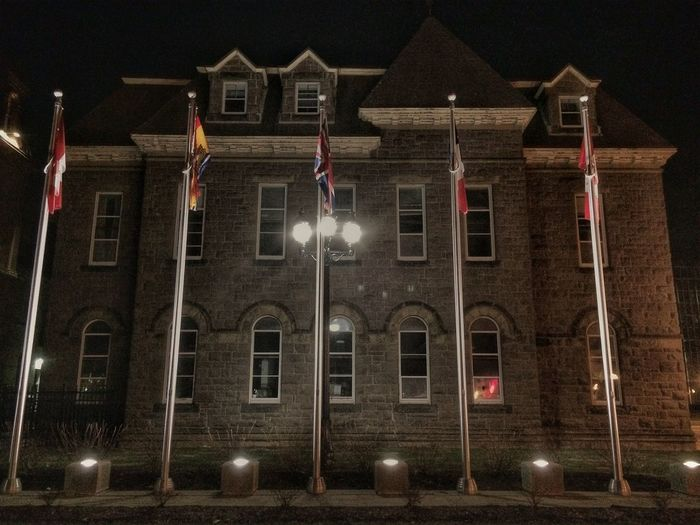New Brunswick provincial legislative department offices, Fredericton, NB. Provincial Legislative Offices Flags Stone Architecture Night Photography IPhone 5S Snapseed #squaready