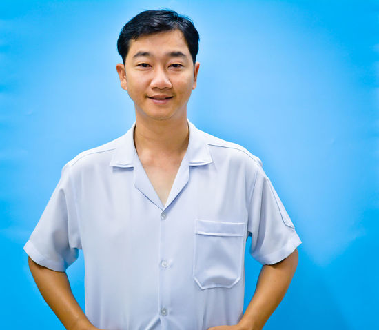 Adult Adults Only Blue Cheerful Close-up Day Formal Portrait One Man Only One Person Only Men People Portrait Real People Sky Smiling Standing Studio Shot Young Adult