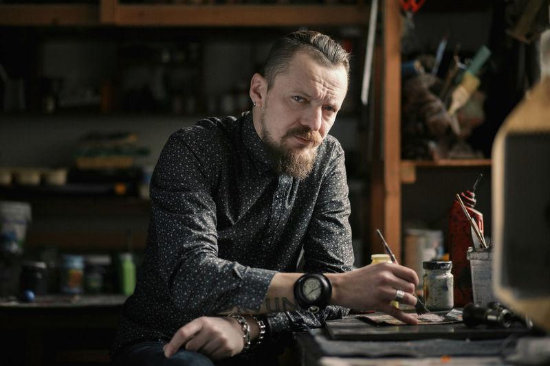 Portrait of man sitting at workshop