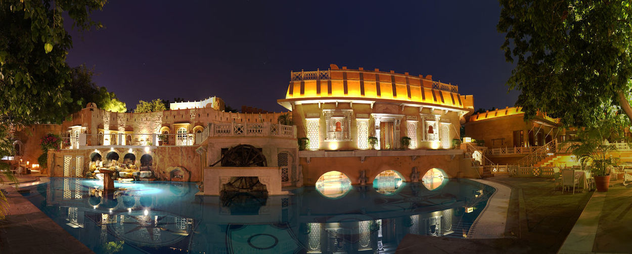Ajit Bhawan in Jodhpur Architecture Night Building Exterior Built Structure Illuminated Reflection City Travel Destinations Tree Nature Water Sky The Past History No People Plant Building Tourism Outdoors Luxury Heritage Heritage Hotel Pool India