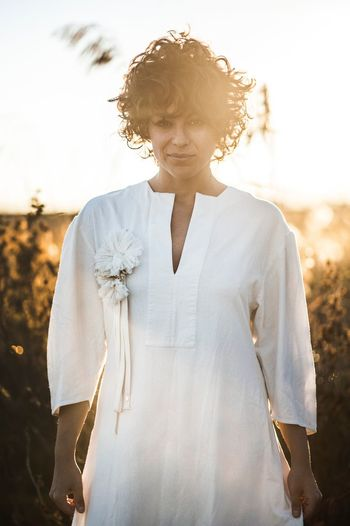 EyeEm Selects One Person Lifestyles Front View Real People Sky Leisure Activity Nature Sunlight Waist Up Casual Clothing Focus On Foreground Curly Hair Standing Day Land Hairstyle Outdoors Field Young Adult Contemplation