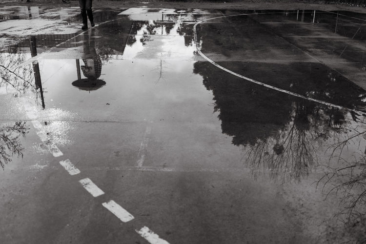 The Street Photographer - 2019 EyeEm Awards Water Wet Transportation Reflection Road High Angle View City Rain Sign Symbol Marking Street Road Marking Day Architecture Nature Puddle Rainy Season No People Outdoors