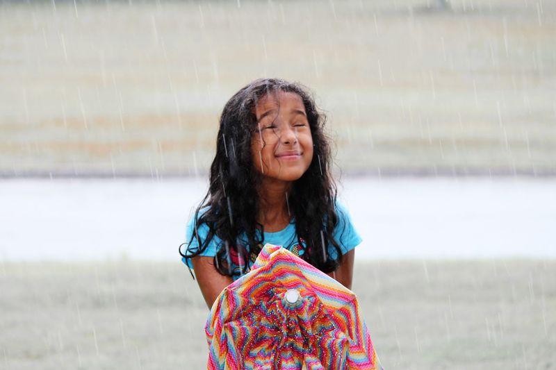 Portrait Of Smiling Girl In Rain