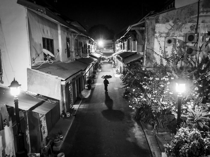The Street Photographer - 2017 EyeEm Awards Melaka Malacca Malaysia Night Night Photography Umbrella Alley Alone One Woman Drizzling Silhouette Shadows Lights Center Leading Lines Walking Alone Perspective Street Photography