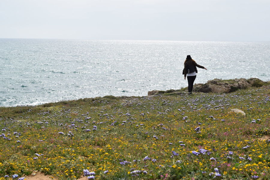 Fragility Horizon Over Water Scenics Blossom Flower Head Blooming Travel Photography Tranquil Scene Springtime Standing Young Women Spring Flowers Traveling Freshness Outdoors Beauty In Nature Spring (null)Growth Women Sea Nature Flower Happy People Flowers The Great Outdoors - 2017 EyeEm Awards