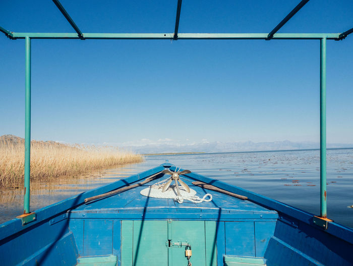 Boat Trip #01 Anchor Balkans Blue Green  Boat Boat Trip Central Perspective Color Palette Day Eyeem Established Here Frame Lake Looking Forward Nature No People Outdoors Pastel Power Rope Ship Skadar Lake, Montenegro Skadarsko Jezero Tranquil Scene Tranquility Travel Water Let's Go. Together.