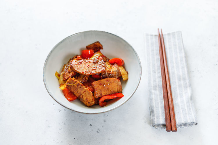 Szechuan Dish ASIA Asian  Food Pork Fried Cooked Vegetables Spicy Chili. Hot White Recipe Portion One Dinner person Sticks Top Above View Plate Bowl Pieces Soy Sauce Fry Wok Chinese Roasted Pan Meat Pepper Bell Leek Onion Food And Drink Still Life