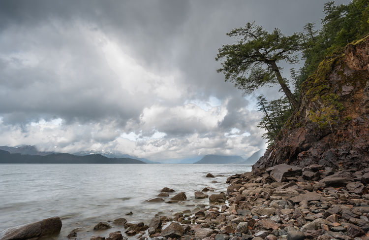 A storm passing over Harrison lake, canada Bear Camping Creek Dark Harrison Isolated Rock Storm Beach Camo Clouds Lake Ocean Outcrop Outdoors Pebble Remote River Rock Rv Secluded  Springtime Summer Tranquility Water