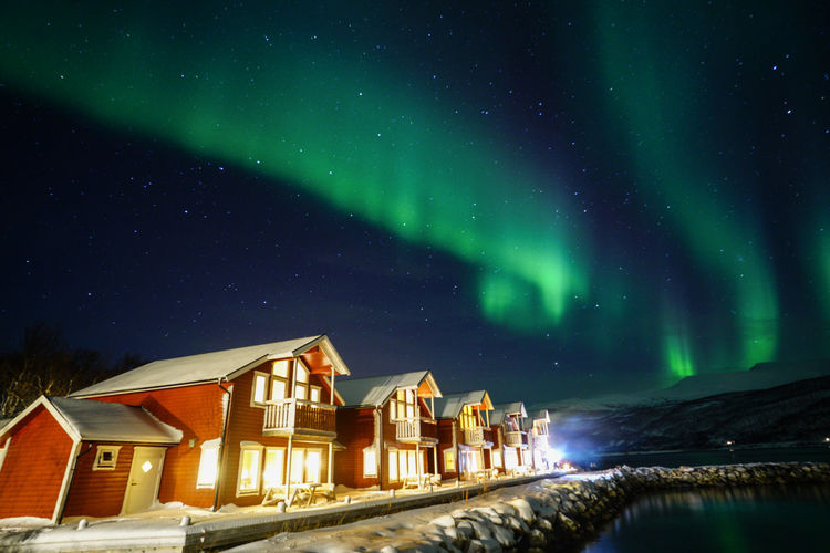 Aurora Borealis Northern Lights Norway Travel Photography Tromsø Winter Architecture Astronomy Aurora Polaris Beauty In Nature Building Exterior Built Structure Constellation Galaxy Green Color Illuminated Nature Night No People Outdoors Polar Night Scenics Sky Star - Space Star Field Svalbard  Travel Destinations Water