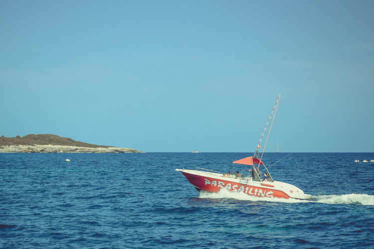Water Sea Nautical Vessel Sky Mode Of Transportation Transportation Waterfront Horizon Over Water Nature Day Horizon Copy Space Blue Beauty In Nature Scenics - Nature Clear Sky Text Travel Outdoors Parasailing Peninsula