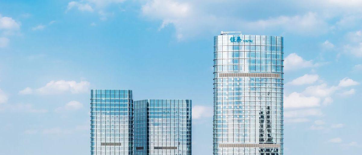 Modern skyscraper against sky