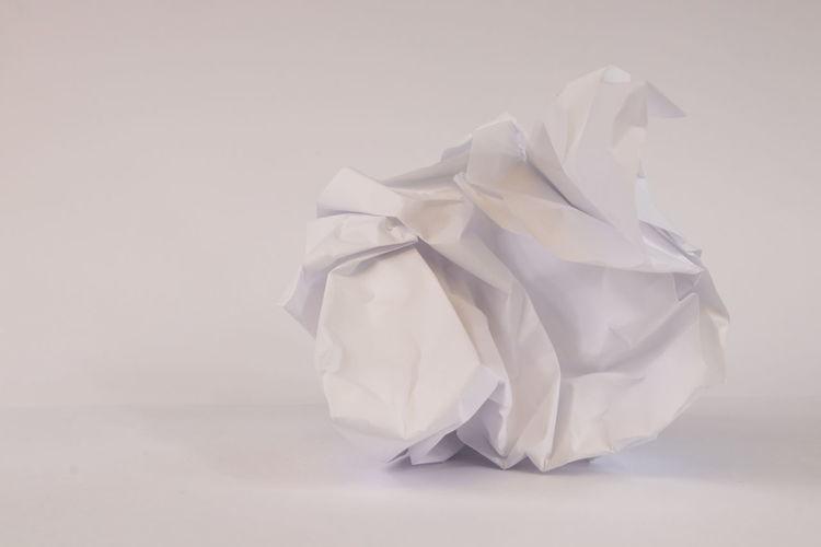 Close-up of white umbrella on paper