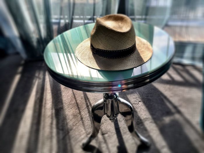 High angle view of hat on table