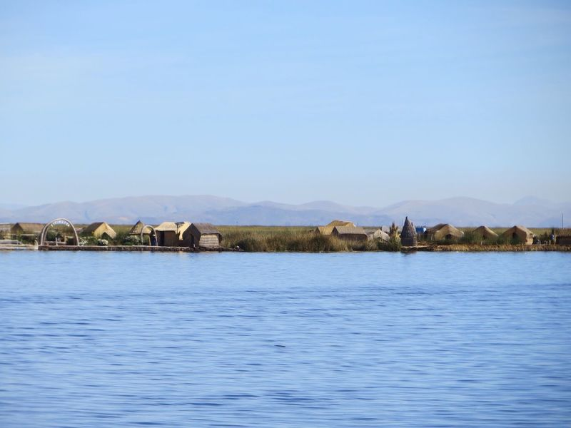 Waterfront Built Structure Architecture Water Outdoors Lake Nature Day No People Tranquil Scene Tranquility Scenics Blue Clear Sky Building Exterior Mountain Beauty In Nature Sky Lake Titicaca Uru Uros Puno, Perú Peru Ancient Civilization Tranquility