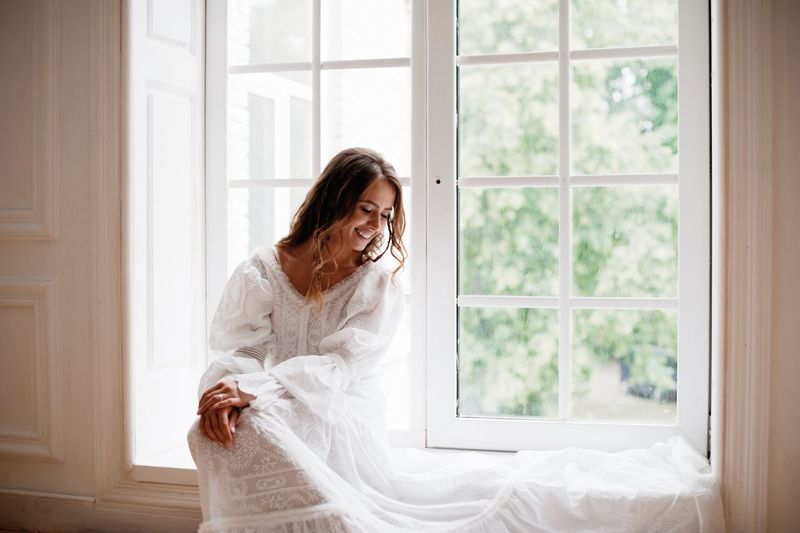 beautiful young girl in white dress sits by the window Window One Person Women Indoors  Adult Lifestyles Standing White Color Three Quarter Length Hair Contemplation Females Hairstyle Home Interior Brown Hair Domestic Life Nature Emotion Beautiful Woman The Portraitist - 2018 EyeEm Awards The Fashion Photographer - 2018 EyeEm Awards