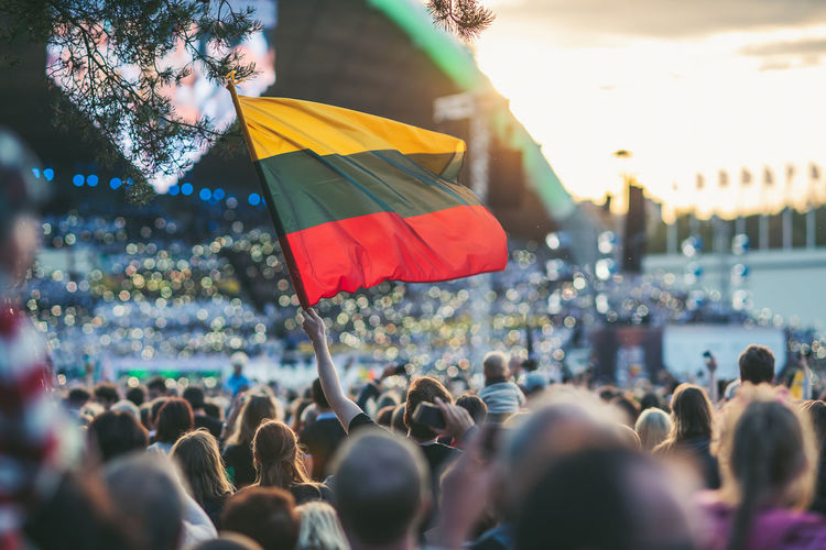 Lithuanian Flag. Statehood Day is an annual public holiday in Lithuania celebrated on July 6 to commemorate the coronation in 1253 of Mindaugas as the only King of Lithuania. Lithuanian Flag Adult Architecture Celebration Crowd Day Emotion Event Flag Group Of People Large Group Of People Lifestyles Men Nature Outdoors Real People Selective Focus Spectator Statehood Day Togetherness Women The Photojournalist - 2018 EyeEm Awards