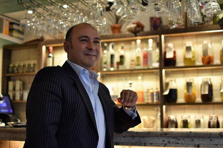 Smiling mature man sitting in restaurant