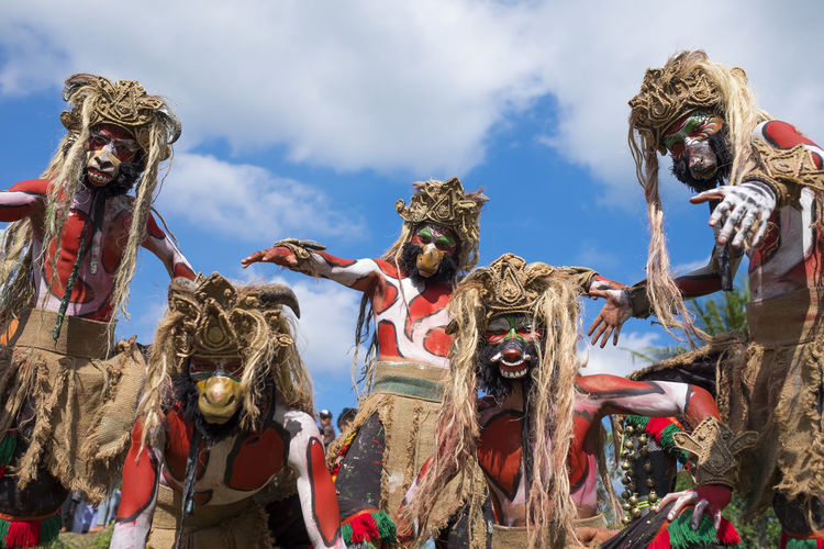 Magelang, Indonesia - June 24, 2016: Jatilan dance before performance at the Five Mountains Festival. The event was held to celebrate local art and culture. Architecture Art And Craft Built Structure Cloud - Sky Craft Creativity Day Human Representation Low Angle View Male Likeness Nature No People Outdoors Representation Sculpture Sky Statue
