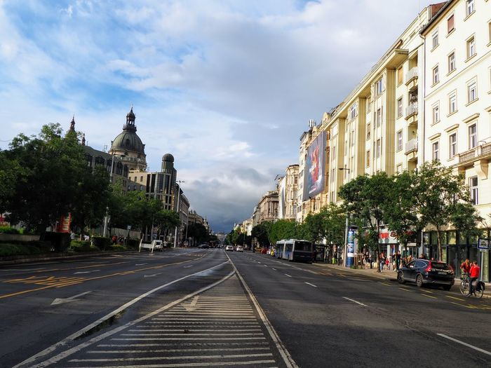 View of city street and buildings against sky