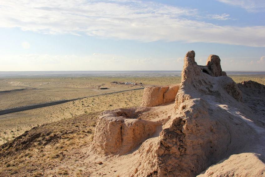 Beach Beauty In Nature Cloud - Sky Day Desert Desert Landscape Fort Fortress Khiva Landscape Nature No People Outdoors Rock - Object Ruins Sand Scenics Sea Sky Sunlight Tranquil Scene Tranquility Uzbekistan