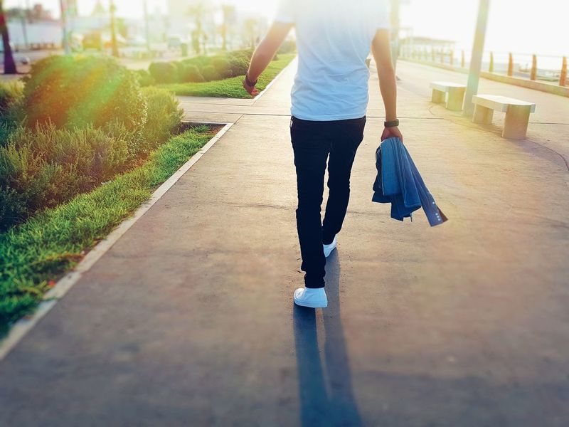 One Person Casual Clothing Adult Adults Only Outdoors Day People Lifestyles Low Section Young Adult One Young Woman Only City Sky Jogging Sunlight Healthy Lifestyle Business Business Concept Goals Goal Rehabilitation Walking Success Business Man Only Women
