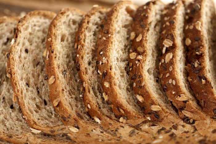Sliced multigrain bread on cutting board. High angle view Breakfast Diet Natural Wheat Bake Baked Bakery Bread Brown Bread Close-up Crust Directly Above Food Food And Drink Grain Loaf Loaf Of Bread Multigrainbread No People Sliced Sliced Bread Studio Photography Whole Wheat Wholegrain Wholemeal Bread