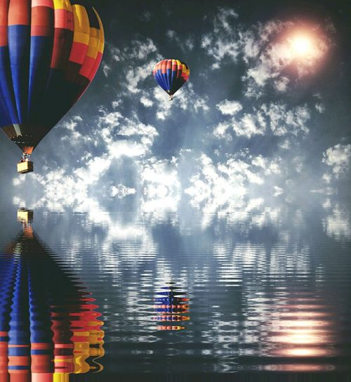 Reflection Hot Air Balloon Flying Sky Cloud - Sky Multi Colored Water Mid-air Adventure Outdoors Tree Day Nature No People Beauty In Nature