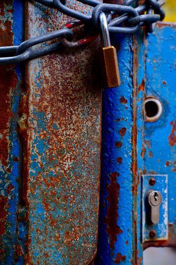 Close-up of padlock on rusty chain