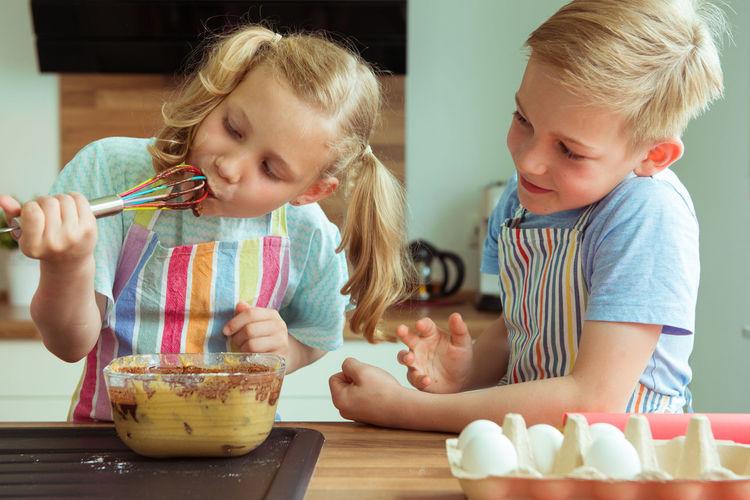Cute girl preparing food on table