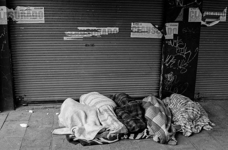 Sleeping outside house