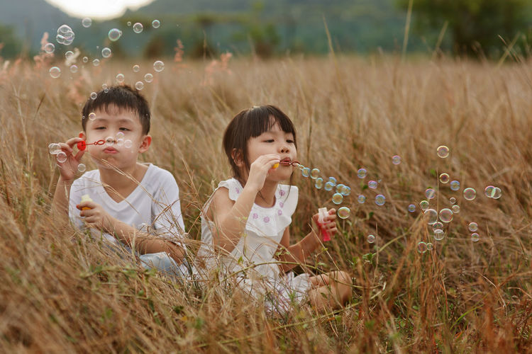 Kids Boys Cheerful Child Childhood Field Fields Grassland Innocence Land Outdoors Plant Togetherness Two People This Is Family