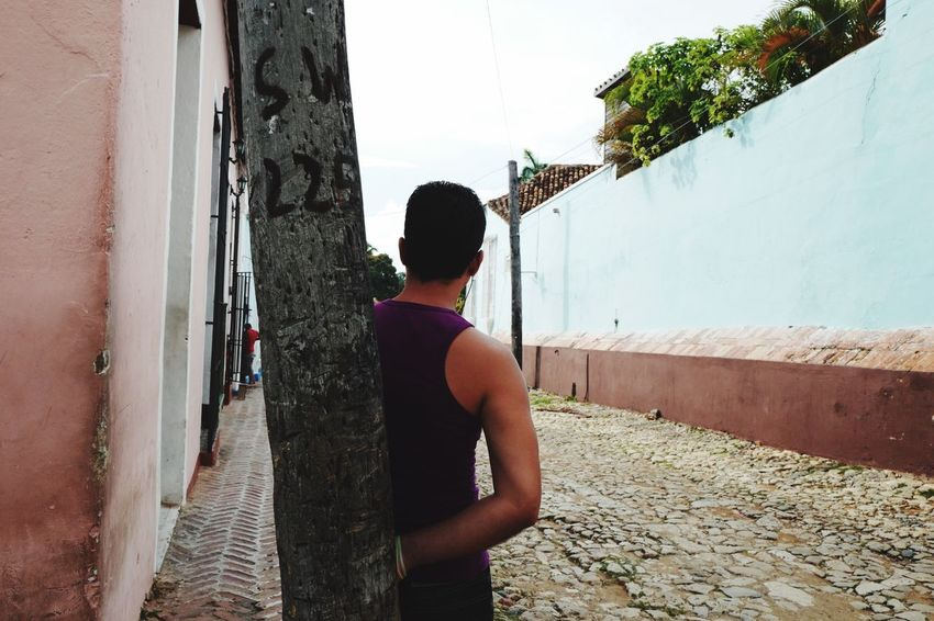 Standing Rear View Three Quarter Length Wall - Building Feature Wall Built Structure Architecture Lifestyles Casual Clothing Day Outdoors Footpath Looking Domestic Life Cuban Style