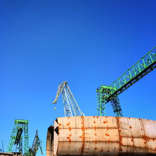 Blue Copy Space Clear Sky Low Angle View No People Outdoors Day Industry Built Structure Architecture Construction Gdansk Poland Heavy Industry Ship Ship Building Shipbuilding Yard Shipbuilding Sky Construction Vehicle