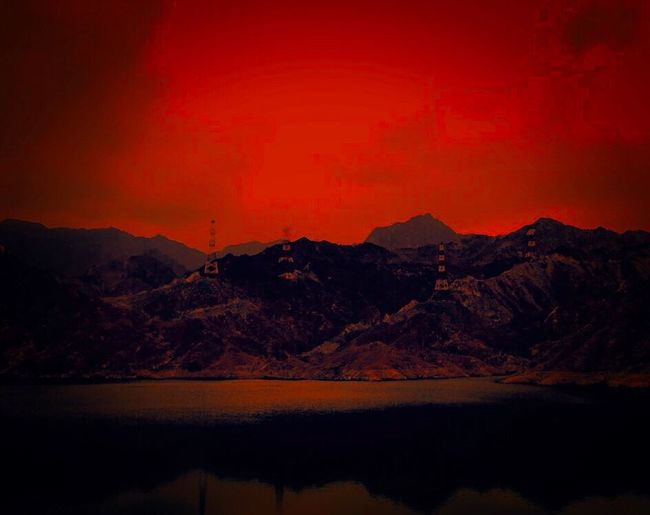 Mountain Reflection Sunset Nature Red Scenics Beauty In Nature Sky Landscape Tranquility Outdoors No People Day