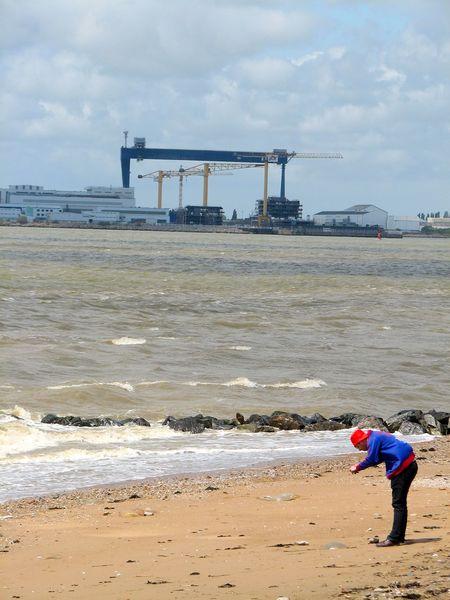 A person taking a picture. Crane Crane - Construction Machinery Gantry Crane Incidental People Red Hat Saint Nazaire Saint-Brévin Shipbuilding