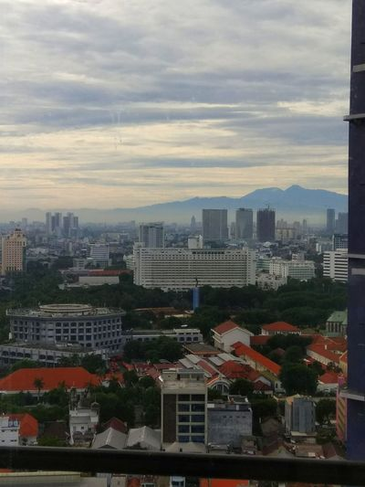 Architecture Cityscape Urban Skyline Sky Day Outdoors Skyscraper City Mountain View Mountain Peak Salak Mountain From My Point Of View Jakarta Buildings Downtown District Centre Of Jakarta After Rain Clear Views In The Morning My Town Pasar Baru Jakarta The Graphic City